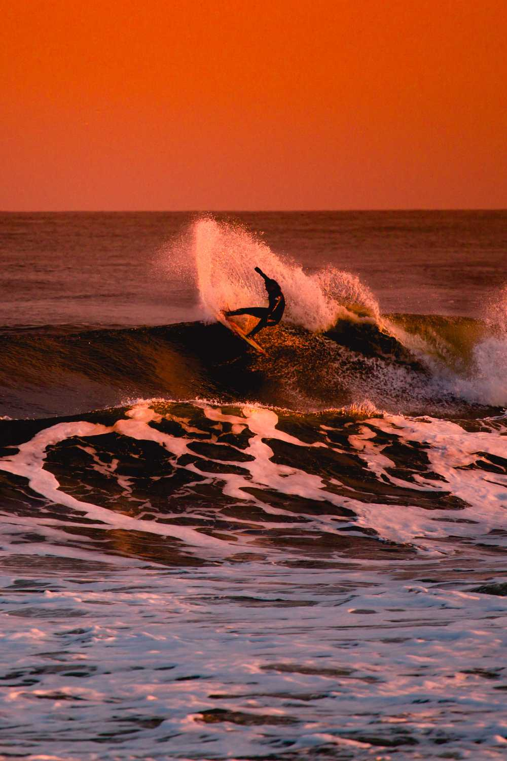person surfing during sunset