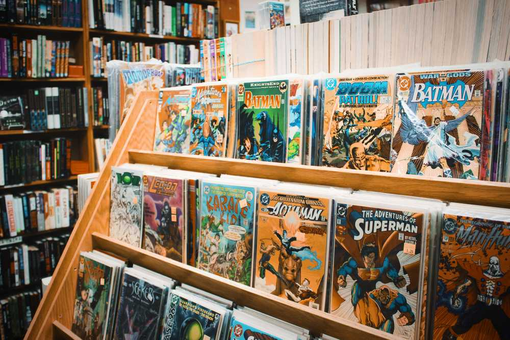 assorted comic book on brown wooden shelf