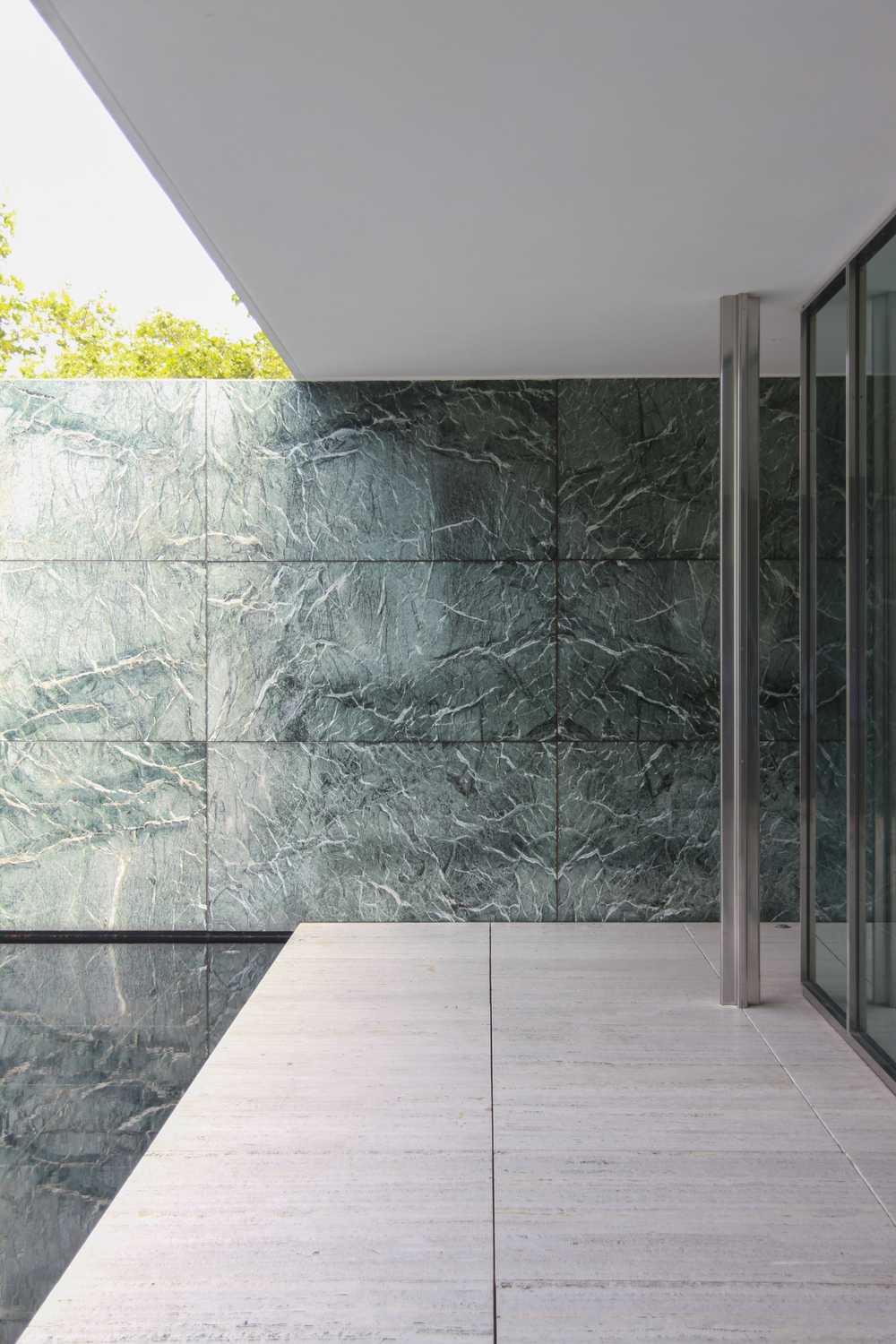 clear glass door near tile wal