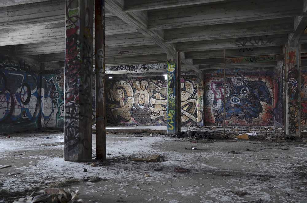 gray concrete building with graffiti on walls