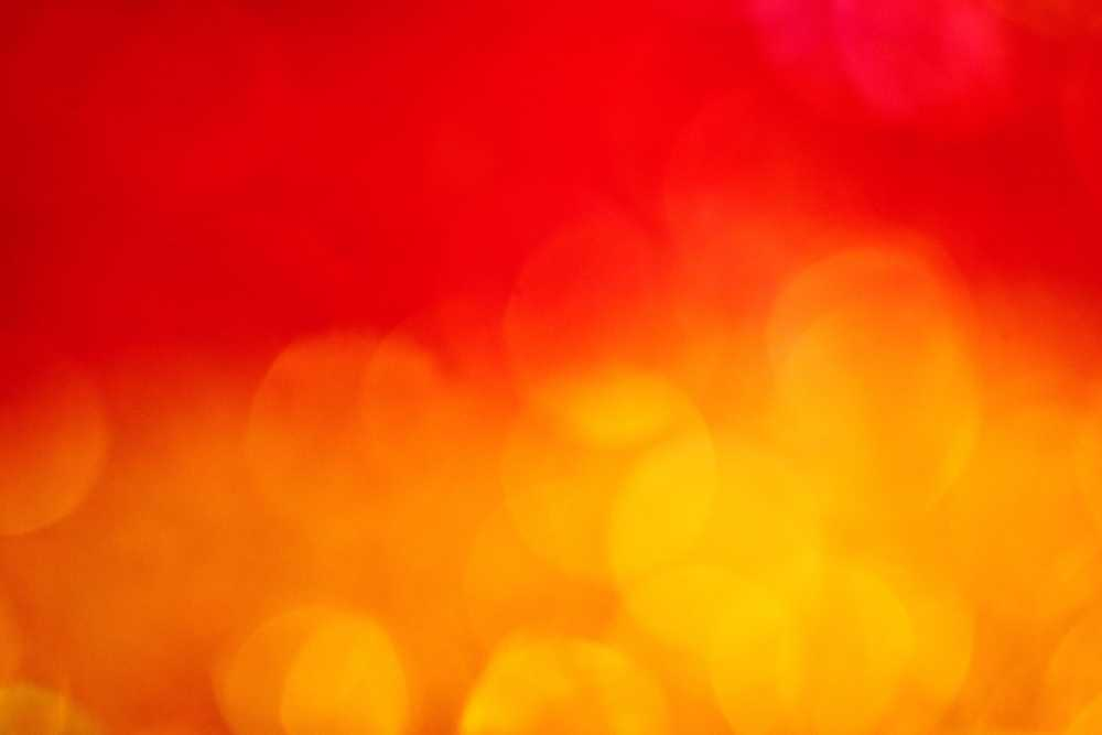 Warm red and orange bokeh fire background wallpaper.