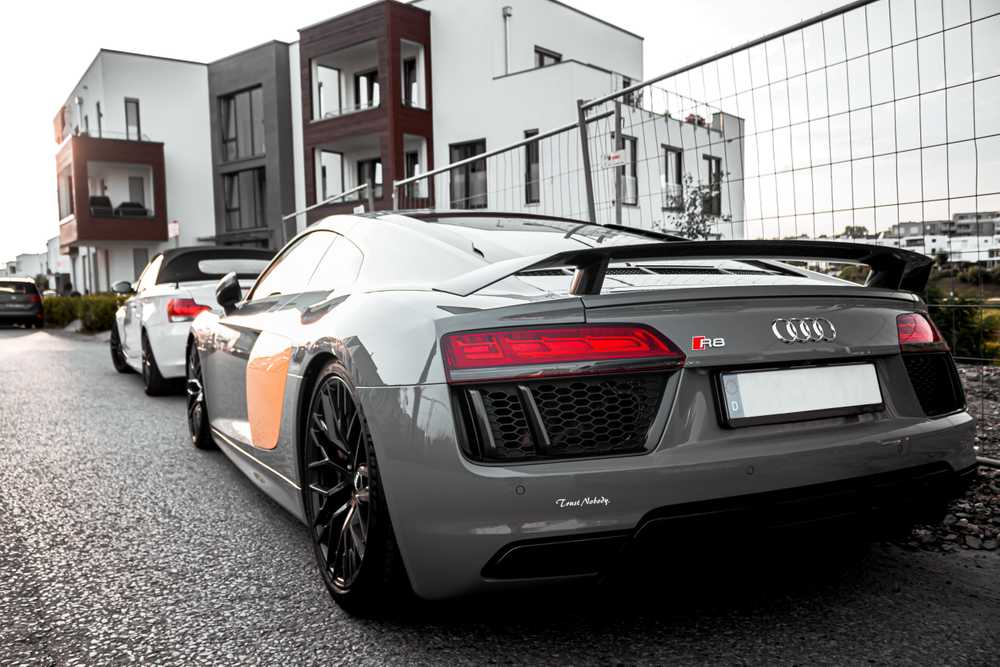 grey Audi R8 coupe parked near fence