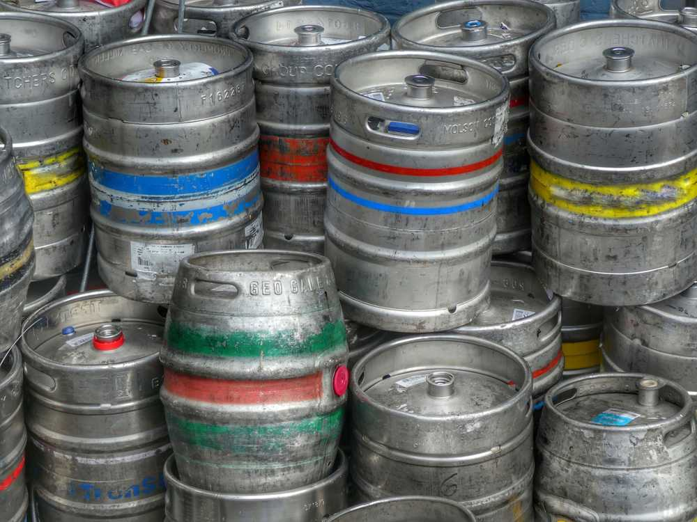 Products and Brands and a collection of beer barrels out side a public house in Dorset.  Colourful and simple.
