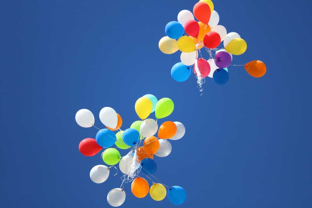 assorted-color balloons flying on sky during daytime