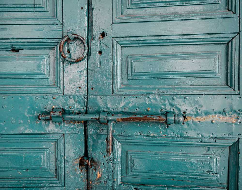 close-up photography of teal door