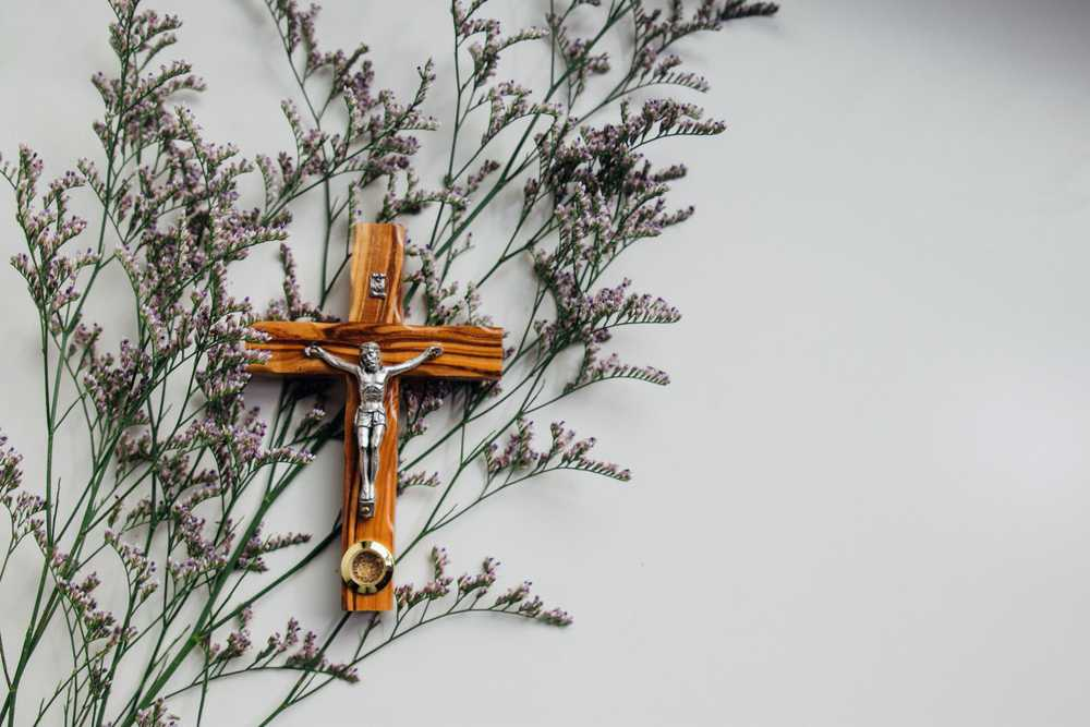 crucifix on wall with flowers