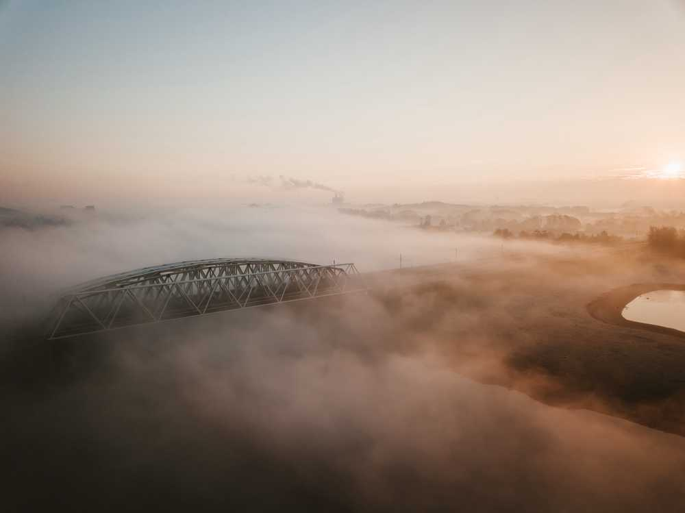 aerial photo of foggy bridge
