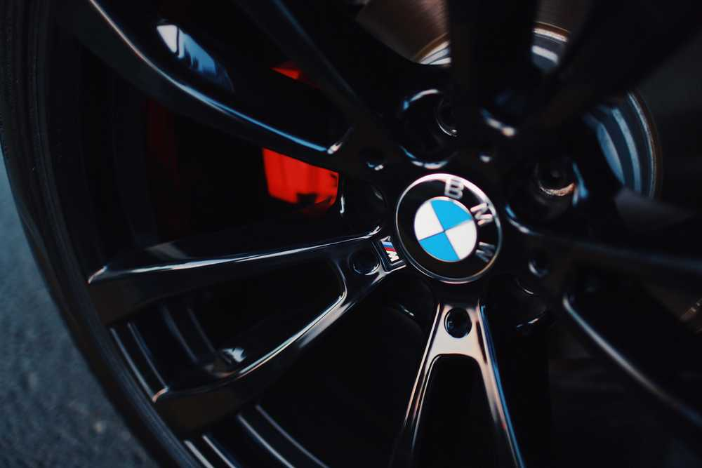 black BMW 5-spoke vehicle wheel with tire