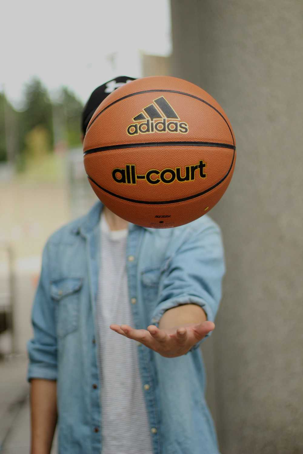 person tossing basketball