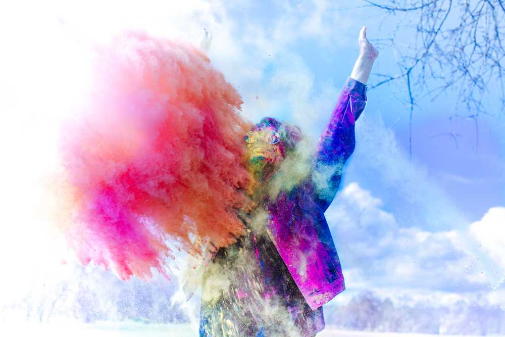 person covered by holi powder