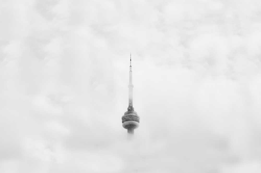 CNN Tower in Canada surrounded by clouds