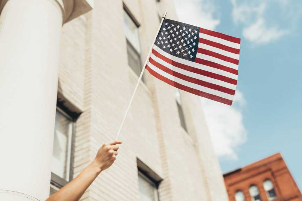 Waving American Flag Across City